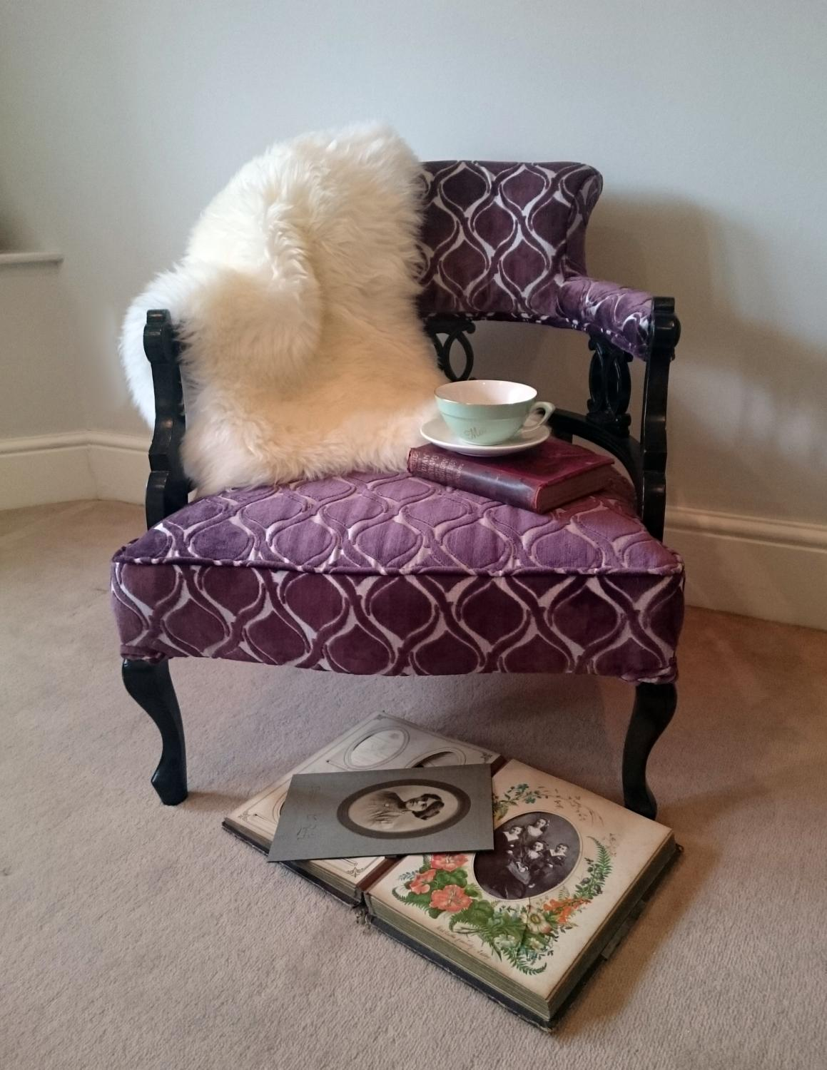 Reupholstered Victorian armchair