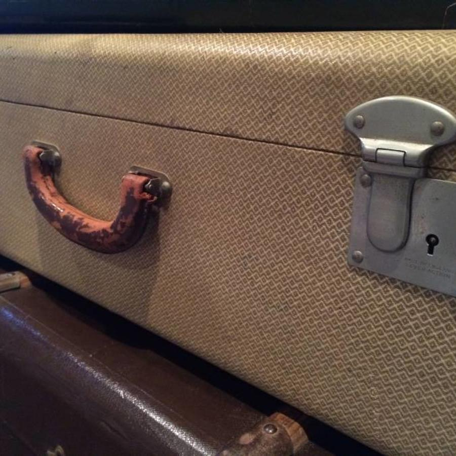 Vintage suitcase featuring a tiered interior