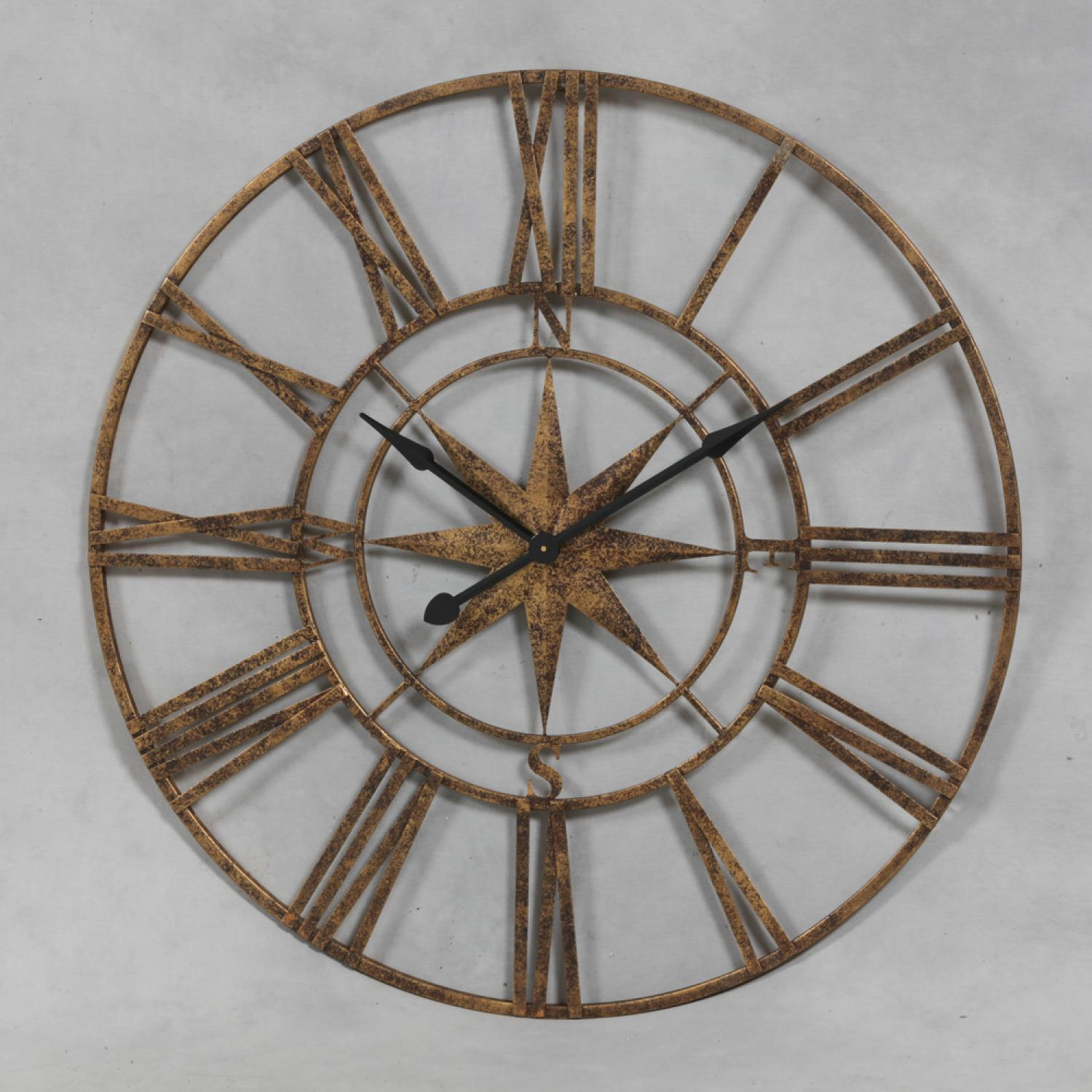 Gold effect compass skeleton clock